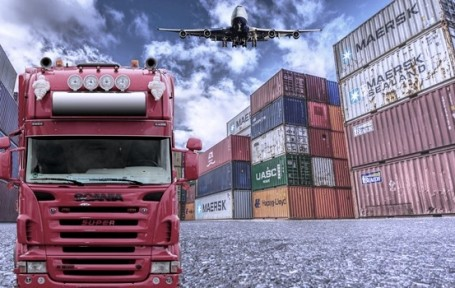 Supply Chain Management: Image of a truck, a cargo plane, numerous cargo containers.